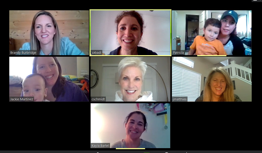smiling coworkers in a video conference call