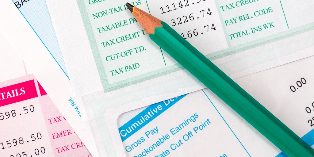 Paystubs Scattered Together with a Pencil Laying on Top California Employers Opt Out of Employee Tax Deferral Program