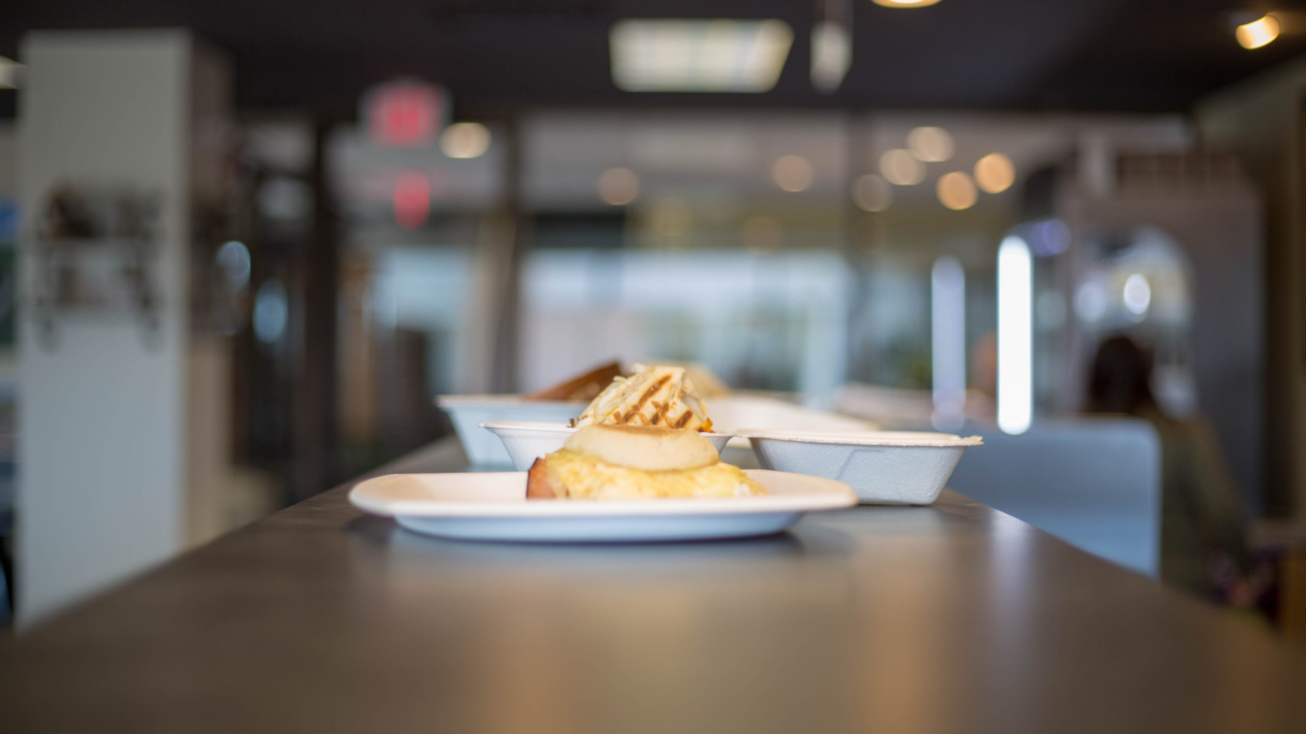 a slice of pie on a plate with a blurred background of a restaurant